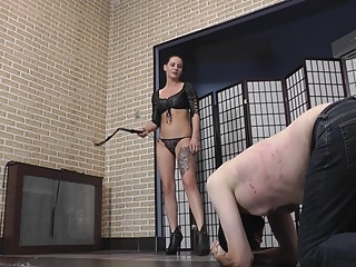 Hot brunette mistress in leather bra whipping her slave bdsm brunette femdom